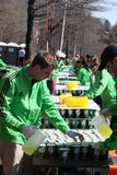 Volunteers gave water to runners during the Boston Stock Images