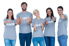 Volunteers gesturing thumbs up Royalty Free Stock Photography