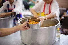 Volunteers are giving food to the homeless poor : the concept of humane.  stock images