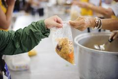 Volunteers are giving food to the homeless poor : the concept of humane.  royalty free stock photo