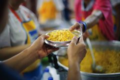 Volunteers are giving food to the homeless poor : the concept of humane.  stock photography