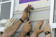 Free Volunteers Installing Sidiing On A New House Stock Images - 256104