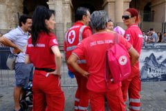 Volunteers of the Italian Red Cross. Rome, Italy - August 12, 2017: Back turned of volunteers of the Italian Red Cross Croce Rossa or CRI. The Italian Red Cross Stock Image