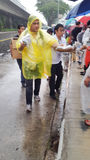 Volunteers - LKY's funeral procession. Volunteers distributing ponchos to people waiting for Mr Lee Kuan Yew's hearse to pass by to bid their final farewell Stock Photos