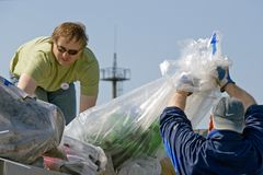 Volunteers loading rubbish royalty free stock photography