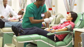 Volunteers Making Blood Donation In Hospital
