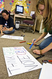 Volunteers making signs Stock Photo
