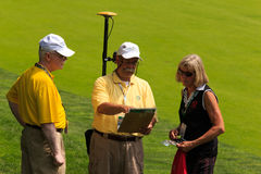 Volunteers at the Memorial. Volunteers learning how to use the electronic range finders at the Memorial Tournament 2013 in Dublin, Ohio, USA Royalty Free Stock Photo
