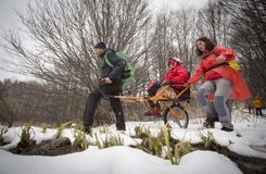 Volunteers and physically disabled at a mountain trip Stock Image