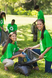 Volunteers picking up litter in park Royalty Free Stock Photography