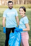 Volunteers portrait with rubbish bags in the park royalty free stock image