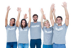Volunteers raising their hands stock photos