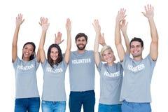 Volunteers raising their hands Stock Photos