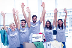 Volunteers raising their hands Royalty Free Stock Photography