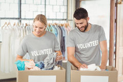 Volunteers separating donations clothes Royalty Free Stock Photography