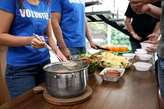 Free Volunteers Serving Food To  People In Charity Centre, Closeup Royalty Free Stock Images - 158290089