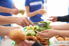Free Volunteers Serving Food To Poor People, Royalty Free Stock Photography - 155787087