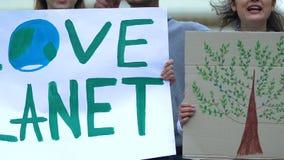 Volunteers showing Love planet slogan, ecological extinction, deforestation