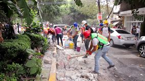 Volunteers smash concrete debris with mallets due the earthquake in Mexico City. Volunteers smash concrete debris with mallets, during one day more of help due stock video