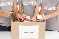 Volunteers sorting donations. In the office stock photo