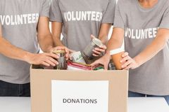 Volunteers sorting donations. In the office royalty free stock photo