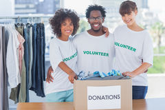 Volunteers standing together in their office Stock Photo