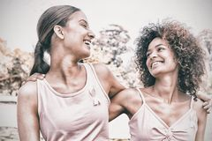 Volunteers supporting breast cancer awareness. Smiling female volunteers supporting breast cancer awareness at park stock images