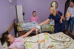 Volunteers team donating clothes for babies in the maternity home during children protection day. In Ukraine Stock Photos