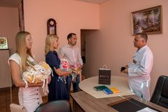Volunteers team donating clothes for babies in the maternity hospital during children protection day. In Ukraine Royalty Free Stock Photos