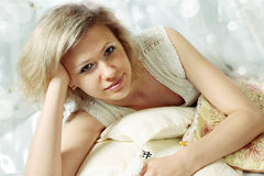 Voluptuous blonde. Beautiful voluptuous blonde lay on the pillows Stock Photos