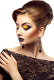 Voluptuous high society woman with closed eye and make up in stu. Dio on white background Royalty Free Stock Photography