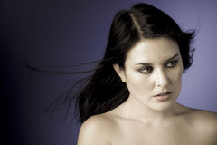 Voluptuous look of brunette young. Woman. intense expression Stock Images