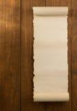 Voluta del pergamino en la madera Foto de archivo