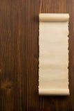 Voluta del pergamino en la madera Fotografía de archivo