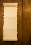 Voluta del pergamino en la madera Imagenes de archivo