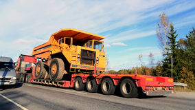 Volvo BM 540 Rigid Dump Truck on Truck Trailer as Wide Load. PARAINEN, FINLAND - OCTOBER 9, 2015: Volvo FH hauls a Volvo BM 540 Rigid dump truck as wide load Royalty Free Stock Image