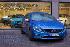 Volvo cars in the Parking lot of autoteller in Stockholm. Car Volvo in the Parking lot of autoteller in Stockholm. New blue car is parked on the sidewalk near Stock Image