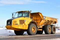 Volvo A35D. NOVYY URENGOY, RUSSIA - MARCH 5, 2014: Yellow Volvo A35D articulated dump truck at the city street royalty free stock photography