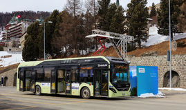Volvo 7900 Electric Hybrid bus at a quick-charge facility in St. Moritz, Switzerland. St. Moritz, Switzerland - 3 March, 2017: a Volvo 7900 Electric Hybrid bus Royalty Free Stock Photo