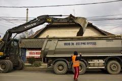 Volvo excavator loading the truck Royalty Free Stock Photo