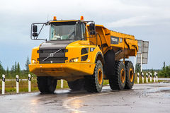 Volvo A25F. NOVYY URENGOY, RUSSIA - JULY 16, 2015: Articulated dump truck Volvo A25F at the interurban road royalty free stock image