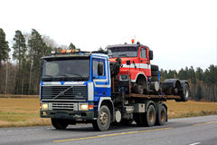 Volvo F10 Transports another Classic Volvo Truck. KAARINA, FINLAND - OCTOBER 21, 2016: Volvo F10 flat bed truck transports a classic conventional Volvo N-series Royalty Free Stock Photography