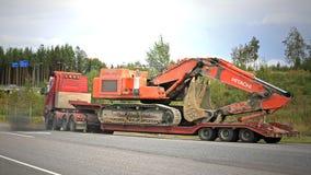 Volvo FH16 Hauls Hitachi Zaxis Excavator Royalty Free Stock Photo