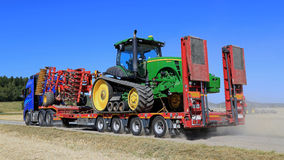 Volvo FH Hauls John Deere Tractor Royalty Free Stock Photos