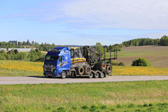 Volvo FH Hauls Ponsse Forest Machinery at Summer Stock Photos
