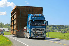 Volvo FH Hauls Wide Load along Highway Royalty Free Stock Photo