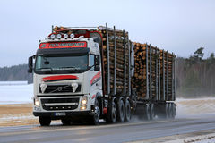 Volvo FH Logging Truck Hauls Wood in Winter stock images
