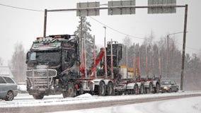 Volvo FH16 580 Logging Truck in Snowfall Stock Photos