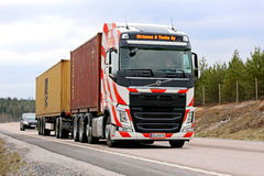 Volvo FH with Red Stripes Hauls Containers along Road Royalty Free Stock Images
