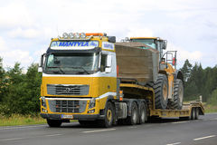 Volvo FH16 Semi Hauls CAT Wheel Loader Royalty Free Stock Photo